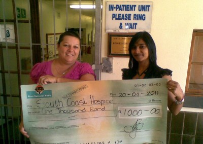 Kajal Lalmun presenting the South Coast Hospice with a donation