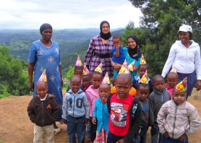 Luthfiya, Sabeehah with the staff and some of the children at the IMA Clinic