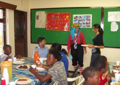 Mr Lockhat, Shuvee, Priya, Fehmida, Favourite, Kevin and Hebert take a photo at the orphans party