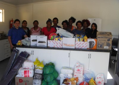 Staff from Coastal Accounting and iKhayalethu with some of the donated goods