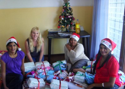 Praneshree, Favourite and Charmaine presenting gifts to staff at the home