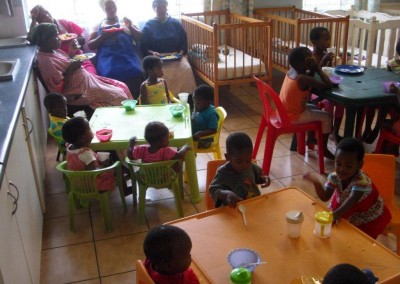 Staff and the children from Assisisi enjoying a wonderful lunch