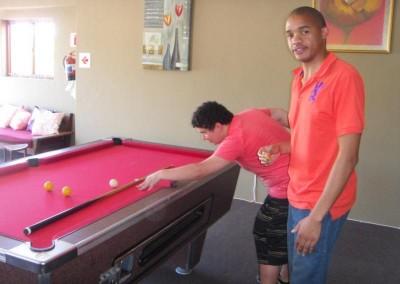Pieter and Herbert engrossed in their pool game