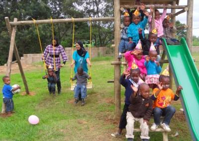 Luthfiya, Sabeehah and the children enjoying their new jungle gym